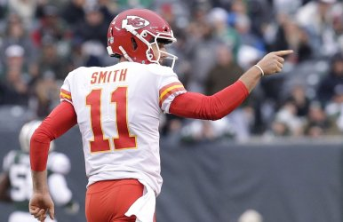 Chiefs Alex Smith reacts after throwing a touchdown pass