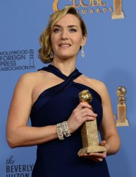 Kate Winslet wins an award at the 73rd annual Golden Globe Awards in Beverly Hills