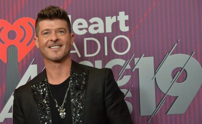 Robin Thicke backstage at iHeartRadio Music Awards in Los Angeles