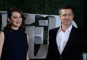 "Marion Cotillard and Brad Pitt attend the ""Allied"" premiere in Los Angeles"