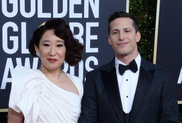 Sandra Oh and Andy Samberg attend Golden Globe Awards