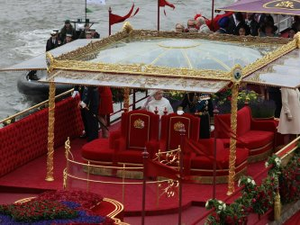 Queen Elizabeth II waves to the people during the Royal Diamond Jubilee Pageant in London
