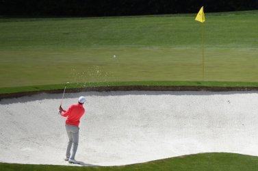 Soren Kjeldsen of Denmark hits out of a bunker at the Masters