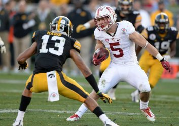 Cardinal back Christian McCaffrey (5)  jukes by Hawkeyes DB Greg Mabin