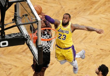 Lakers LeBron James eaches for a rebound