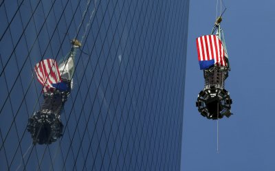 Final piece of spire raised to top of One World Trade Center