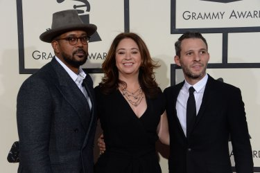 Justin Wilkes, Liz Garbus and Jayson Jackson arrive for the 58th annual Grammy Awards in Los Angeles