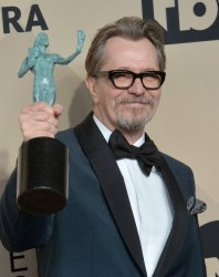 Gary Oldman wins an award at the 24th annual SAG Awards in Los Angeles