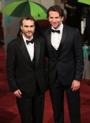 Joaquin Phoenix and Bradley Cooper arrive at the Baftas Awards Ceremony