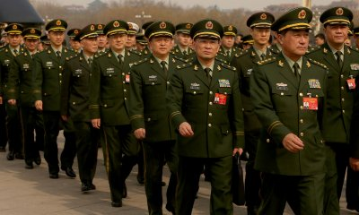 Military delegates arrive for the NPC in Beijing, China