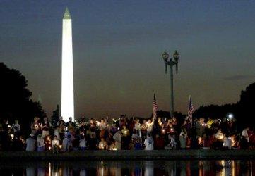 Candle Light Vigil Expresses Sorrow, Defians
