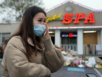 Woman Mourns Outside Gold Spa afterMass Murder in Atlanta