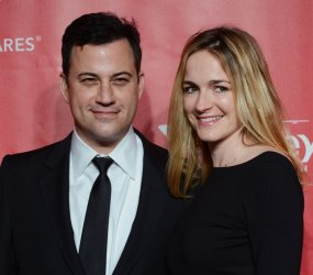 TV host Jimmy Kimmel and Molly McNearney arrive at 2013 MusiCares Person of the Year gala in Los Angeles