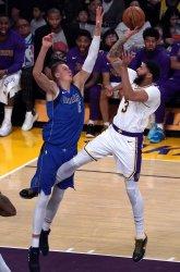 Los Angeles Lakers Anthony Davis scores over Dallas Mavericks Kristaps Porzingis in Los Angeles
