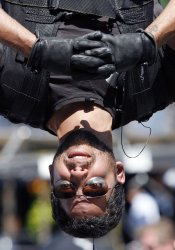 """David Blaine Performs his """"Dive of Death"""" stunt in New York"""
