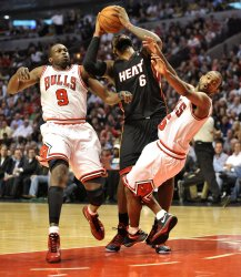 Heat's James fouls Bulls' Lucas in Chicago