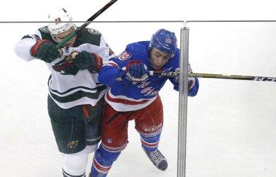 Rangers John Gilmour and Wild Nino Niederreiter collide