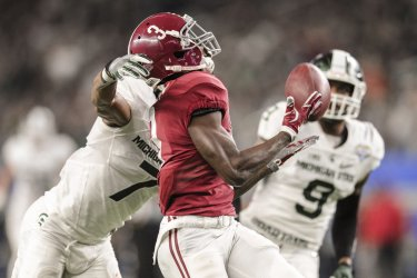 Alabama receiver Demetrious Cox catches a 50 yard pass during the Cotton Bowl