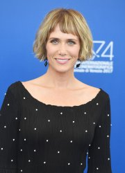Kristen Wiig attends a photo call for Downsizing at the 74th Venice Film Festival