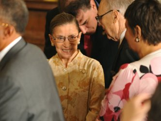 Supreme Court Justice Ruth Bader Ginsburg attends a welcoming ceremony for Supreme Court Jusice Sonia Sotomayor at the White House in Washington