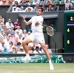 Guido Pella returns the ball in third round action against Kevin Anderson