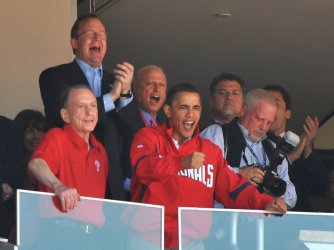 President Obama cheers as the Washington Nationals play the Philadelphia Phillies in Washington