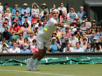 Roger Federer plays a backhand in first round match against Lloyd Harris