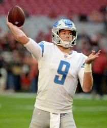 Lions' Stafford warms up before game