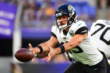 Jaguars QB Gardner Minshew throws shovel pass during an NFL preseason game against Ravens