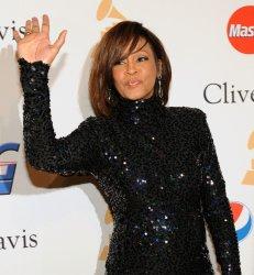 Whitney Houston arrives at pre-Grammy gala honoring David Geffen in Beverly Hills, California
