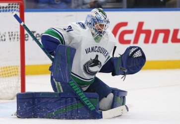 Vancouver Canucks goaltender Anders Nilsson eyes the puck