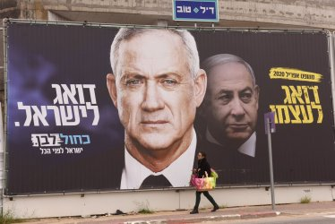 An Israeli Walks Past Election Campaign Posters