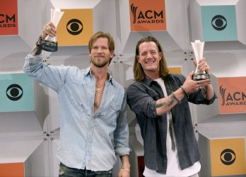 Brian Kelley and Tyler Hubbard win an award backstage at the 51st  annual Academy of Country Music Awards in Las Vegas