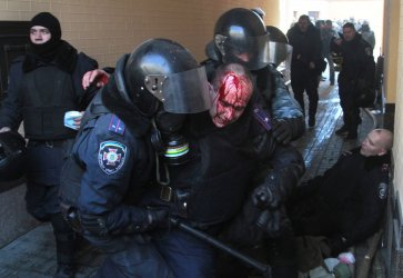 Ukrainian riot police clash with anti-government protesters In Kiev