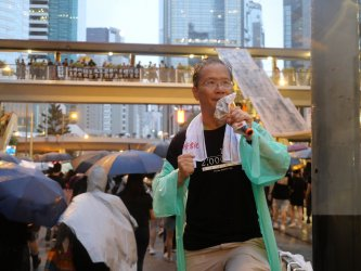 Crowds March in Protest in Hong Kong