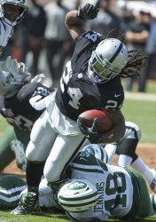 Raiders Marshawn Lynch  tackled by Jets