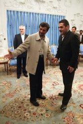 Iran's president Mahmoud Ahmadinejad meets released Lebanese prisoner Samir Qantar in Tehran