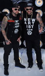 Musicians Benji Madden and Joel Madden from the band Good Charlotte arrive at the 2011 MTV Video Music Awards in Los Angeles