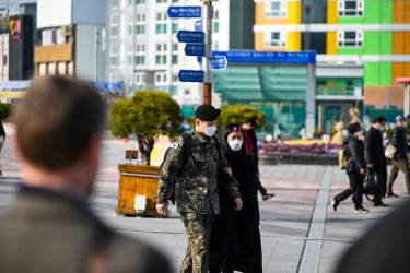 A Soldier and Woman Walk Together in Daegu