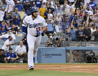 Three Solo Homers, Sytong Pitching Lift Dodgers Over the Giants