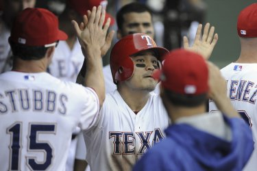 Texas Rangers' Shin-Soo Choo is congratulated by his teammates