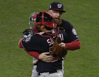 Nats Doolittle and Suzuki hug in World Series in Houston