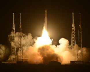 Spacex Falcon 9 launches first commercial spacecraft to the International Space Station for NASA