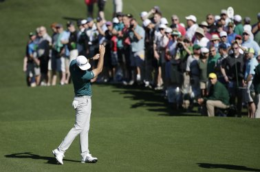 Dustin Johnson makes a practice swing  at the Masters