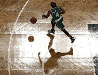 Boston Celtics Isaiah Thomas brings the ball up the court