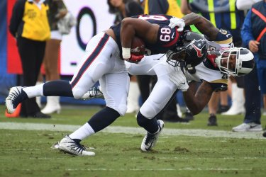 Texans' tight end Stephen Anderson (89) is tackled by Rams cornerback Trumaine Johnson in Los Angeles, California