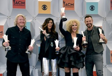 Philip Sweet, Karen Fairchild, Kimberly Schlapman and Jimi Westbrook win an award backstage at the 51st  annual Academy of Country Music Awards in Las Vegas