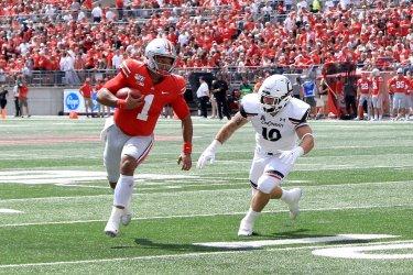 Ohio State's Fields runs past Cincinnati's Tucky