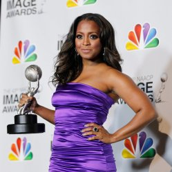 Actress Keshia Knight Pulliam holds her award for Outstanding Supporting Actress in a Comedy Series at the 43rd NAACP Image Awards in Los Angeles