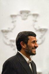 Iran's President Mahmoud Ahmadinejad meets Philippine's Foreign Minister Alberto Romulo.
